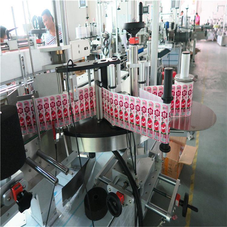 Aplicador de etiquetas adhesivas para la parte delantera trasera y envolvente de la botella